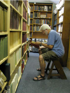 Figure 13.  Jack Beckman absorbed in the collection of a centuries' worth of L'umile Piantas, the journal for the graduates of Mason's House of Education.