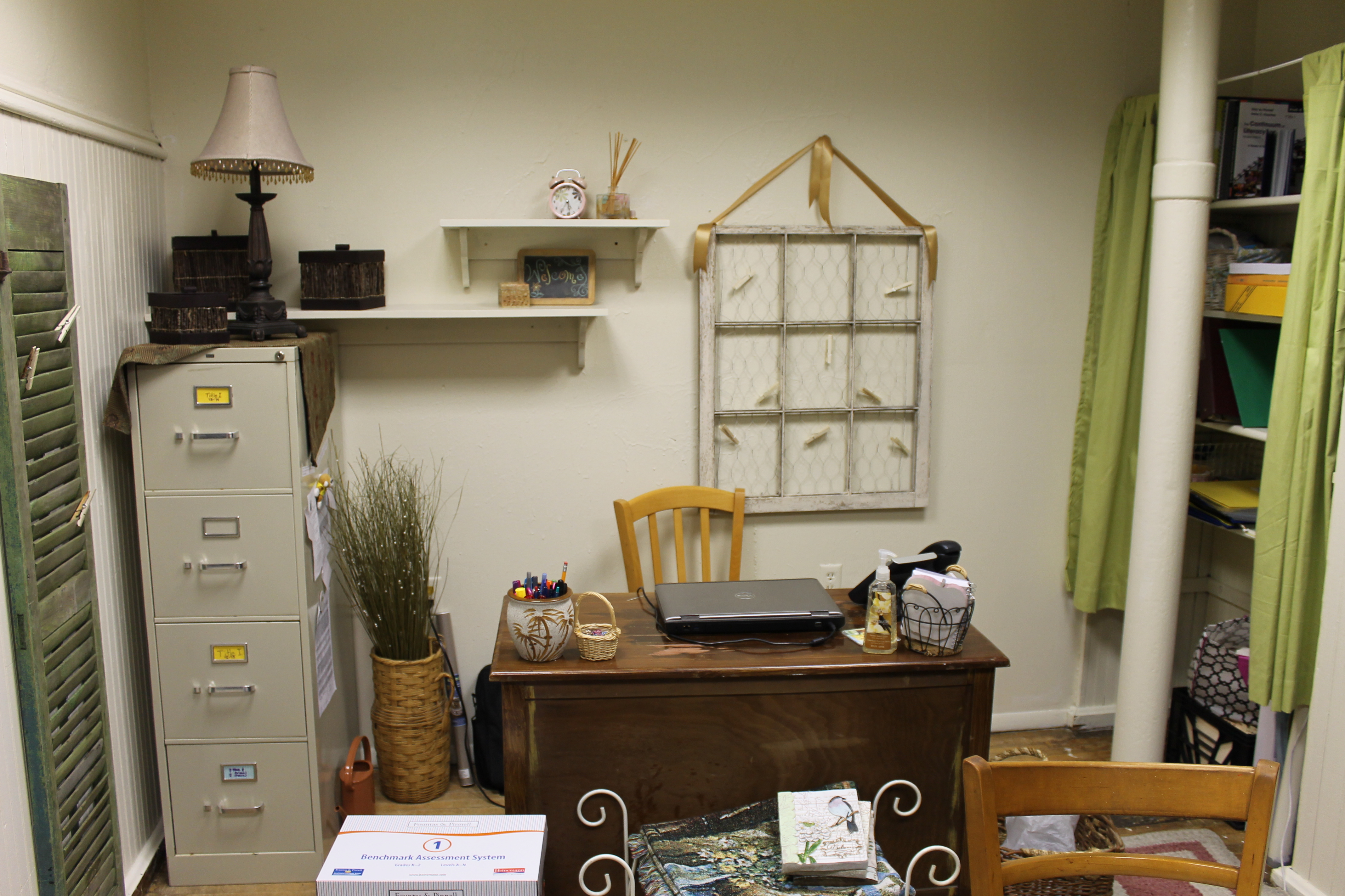 This Old window, desk and other items found at yard sales which give this Title I learning place a charm.